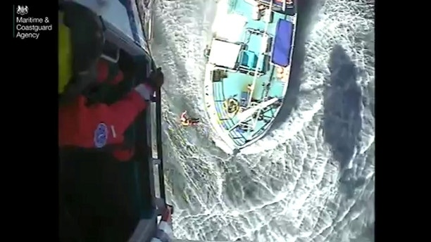 This dramatic video shows the coastguard hauling a British fisherman to safety after he was bitten by a shark. See SWNS story SWSHARK; The casualty, aged 21, was bitten on the leg by a porbeagle shark after it was hauled onto the vessel 'Govenek of Ladram' in one of their fishing nets. The vessel is based out of Newlyn, Cornwall. After sterilising and dressing the leg wound, the fishing crew alerted HM Coastguard by VHF radio asking for medical assistance.