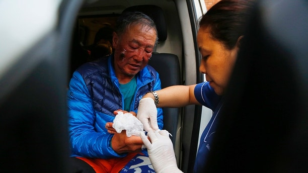 Chinese climber Xia Boyu, 69, gets treated at the hospital after successfully summiting Mount Everest in Kathmandu, Nepal, Wednesday, May 16, 2018. Boyu, who lost his legs while attempting the climb in 1975, has successfully climbed Everest on his fifth attempt. (AP Photo/Niranjan Shrestha)