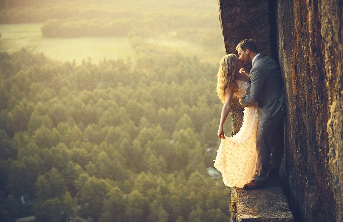 New Hampshire wedding photographers capture couples at stunning heights