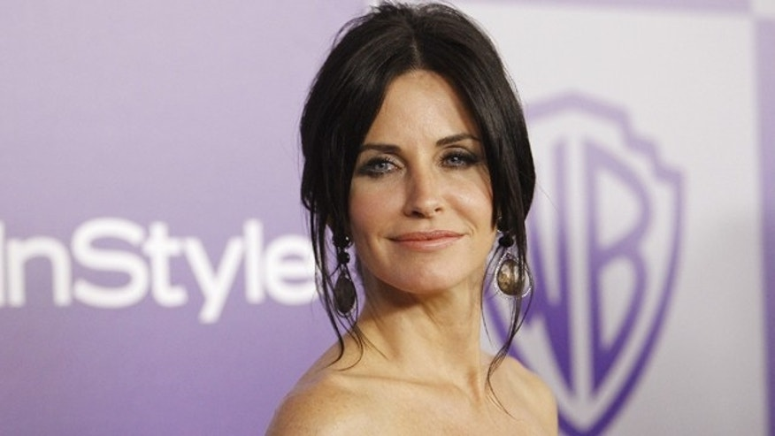 Courteney Cox, star of the TV show 'Cougartown.' In real life, Cox is married to a younger man, David Arquette.