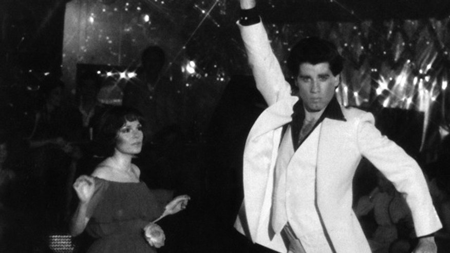 "This is a file photo of John Travolta and Karen Gorney dance in a nightclub scene to disco music in Paramount Pictures 1977 film ""Saturday Night Fever."""