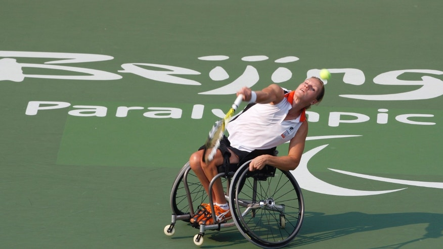 Esther Vergeer of the Netherlands returns a shot to Korie Homan of the Netherlands during the Women's Singles wheelchair tennis Gold Medal Match at the Beijing 2008 Paralympic Games September 14, 2008. REUTERS/Christina Hu (CHINA)