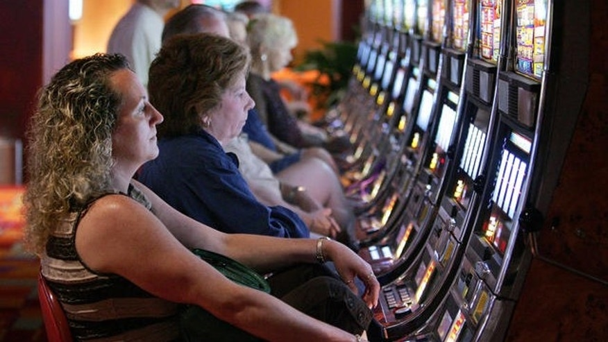 People play slot machines at Philadelphia Park Casino and Racetrack.