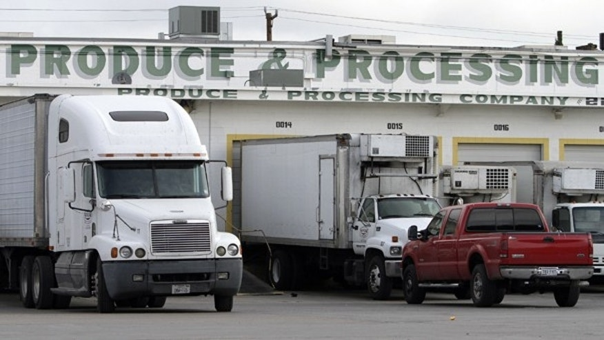 Oct. 21: Trucks are seen in front of the SanGar food processing plant in San Antonio. Texas health officials investigating five deaths have closed the facility and ordered a recall of all products shipped from there since January.