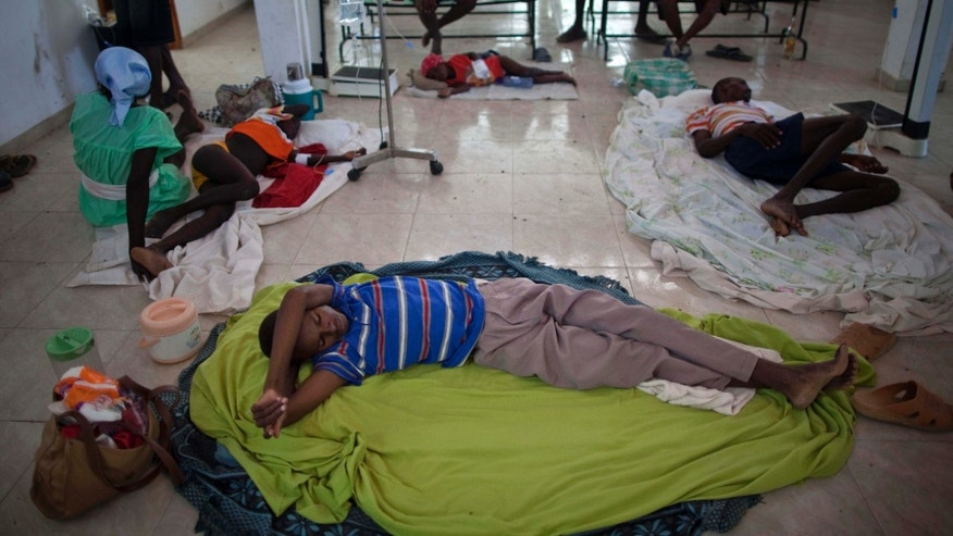 People suffering cholera symptoms rest in a hospital in Grande-Saline, Haiti, Saturday Oct. 23, 2010. A spreading cholera outbreak in rural Haiti threatened to outpace aid groups as they stepped up efforts Saturday hoping to keep the disease from reaching the camps of earthquake survivors in Port-au-Prince. Health officials said at least 208 people had died. (AP Photo/Ramon Espinosa)