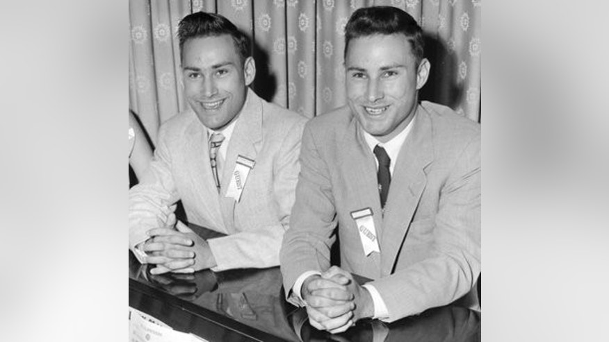 FILE - In this June 4, 1955 file photo, Richard Herrick, left, and his twin brother Ronald, from Northborough, Mass., sing at the annual meeting of the Mended Hearts Club at a hotel in Boston. The identical twin brothers made medical history when Ronald donated one of his kidneys to Richard for a Dec. 23, 1954 kidney transplant that was recognized as the world's first successful organ transplant. Richard lived eight years after receiving the transplant.  Ronald died Monday, Dec. 27, 2010, in Augusta, Maine. He was 79. (AP Photo/File)