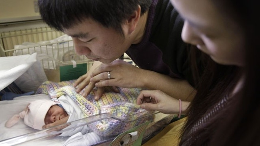 Jan. 11, 2011: Samantha Weng and Wayne Wang look an Audrey Wang, one of their four quadruplets, at Lucile Packard Children's Hospital at Stanford in Palo Alto, Calif.