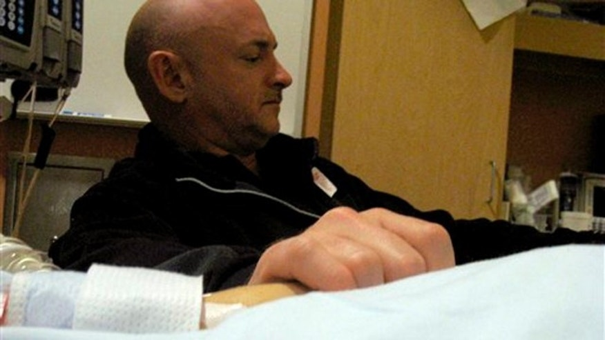 Jan. 9, 2011: Mark Kelly, Giffords' husband, holds the congresswoman's hand in her room at University Medical Center in Tucson, Ariz. (AP/Office of Rep. Gabrielle Giffords)