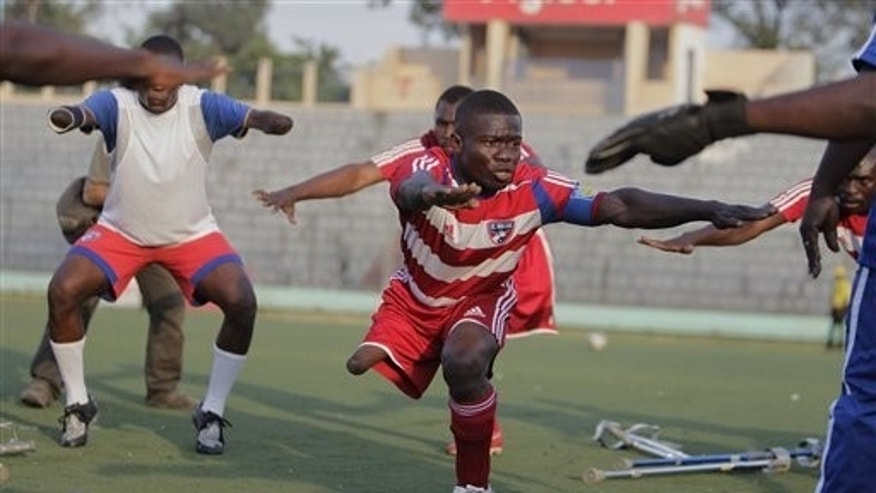 Players belonging to Haiti's unofficial national amputee soccer team warm-up prior to a friendly match against the local Zaryen team in Port-au-Prince, Haiti, Monday Jan 10, 2011.