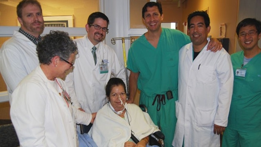 Brenda Charett Jensen surrounded by her surgical team