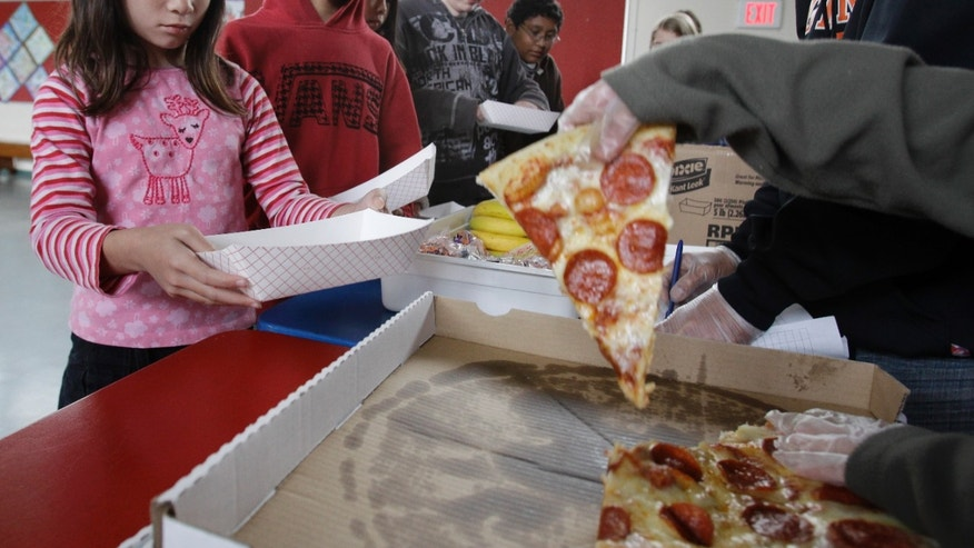 Dec. 2, 2012: A Fairmeadow Elementary School student orders pepperoni pizza during a school lunch program in Palo Alto, Calif.