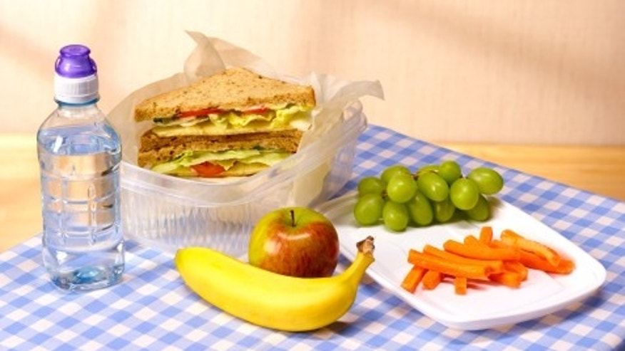 Healthy lunch box on table clot