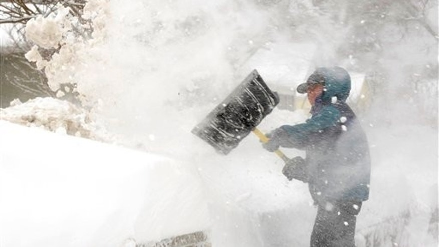 Brooks Chamberlin of Annapolis, Md., shovels the sidewalk near his home  in Annapolis during a blizzard, Wednesday, Feb.  10, 2010. With each shovel full of snow, the wind blows some of it back. (AP Photo/Susan Walsh)