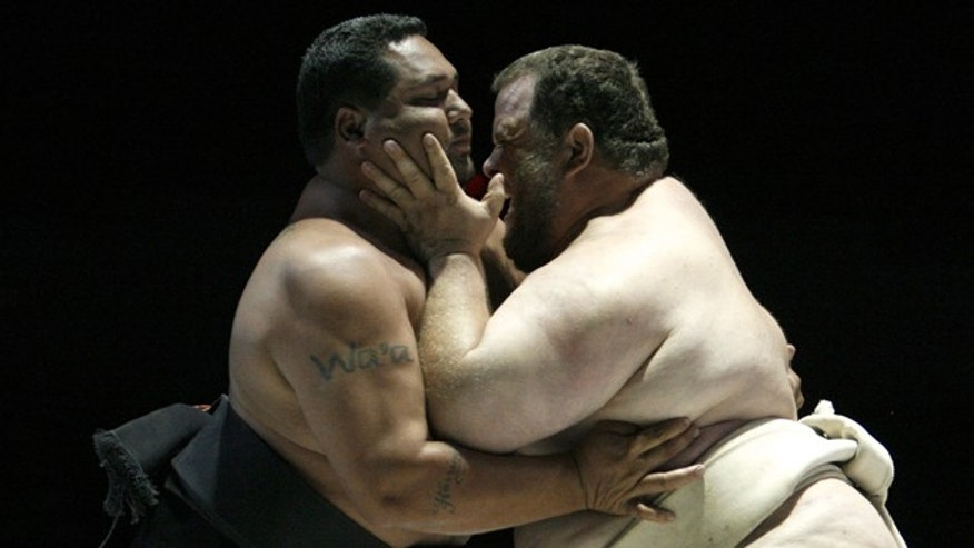 April 8, 2007: Harry Wa'a of U.S. clashes with compatriot Kelly Gneiting at U.S. Sumo Open in Los Angeles.