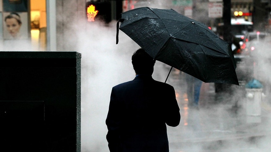 SAN FRANCISCO, CA - FEBRUARY 17:  A pedestrian holds an umbrella as he waits to cross the street in on February 17, 2011 in San Francisco, California.  Wet and stormy weather continues to drench the San Francisco Bay Area and is forecast to continue through the holiday weekend with a 60 percent chance of rain each day until President's Day. (Photo by Justin Sullivan/Getty Images)