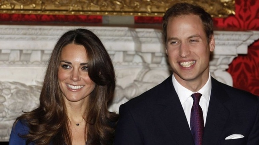 Britain's Prince William and his fiancee Kate Middleton (L) pose for a photograph in St. James's Palace, central London November 16, 2010. Britain's Prince William is to marry his long-term girlfriend Kate Middleton next year, after an on-off courtship lasting nearly a decade, bringing months of speculation about his intentions to an end.    REUTERS/Suzanne Plunkett   (BRITAIN - Tags: SOCIETY ROYALS ENTERTAINMENT PROFILE)
