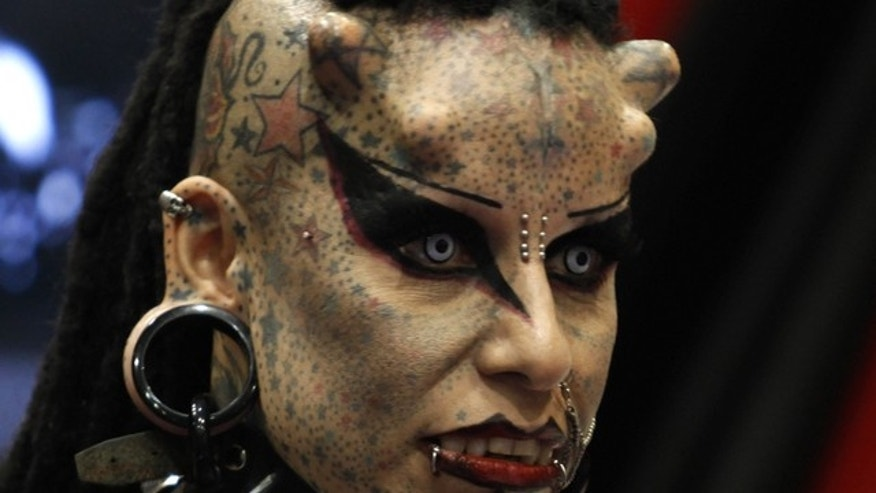 "Mexican tattoo artist Maria Jose Cristerna, known as 'Mujer Vampiro' (Vampire Woman), attends a photo opportunity during the ""Expo Tatuaje"" international tattoo expo in Monterrey April 3, 2011."