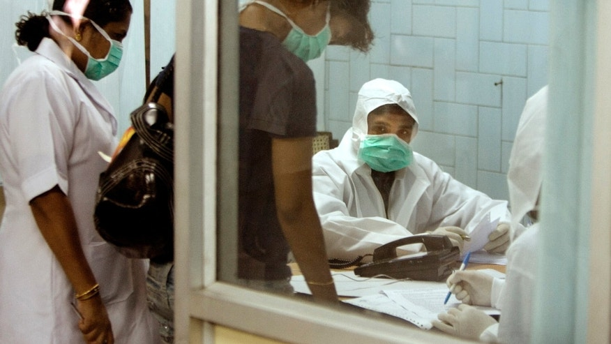 Doctors interview a person who has come for the swine flu virus test at  Ram Manohar Lohia hospital, in New Delhi, India, Thursday, Aug. 6, 2009. The western Indian city Pune reported the country's first swine flu fatality late Monday. India has confirmed 574 swine flu cases, according to the Health Ministry. (AP Photo/Manish Swarup)