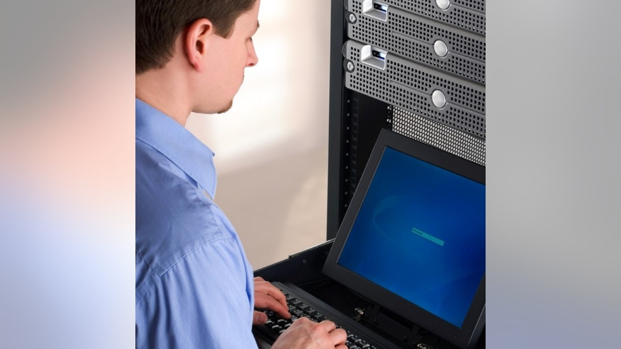 Young IT Professional Managing Network Servers.