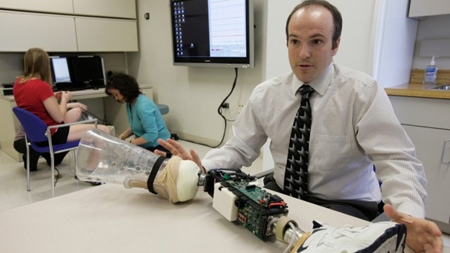 Research scientist Levi Hargrove describes a robotic prosthesis at the Rehabilitation Institute of Chicago's Center for Bionic Medicine, April 13, 2011.