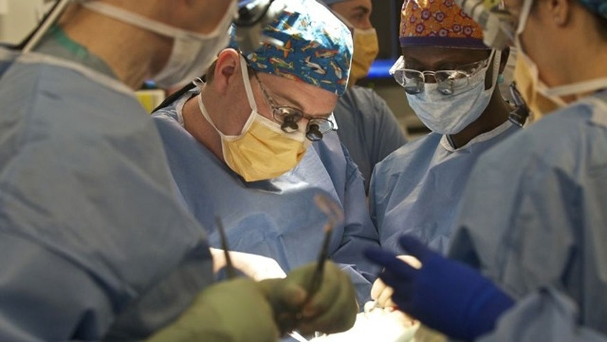 The surgical team at Brigham and Women's hospital performs the nation's second full-face transplant on a 30-year-old patient.