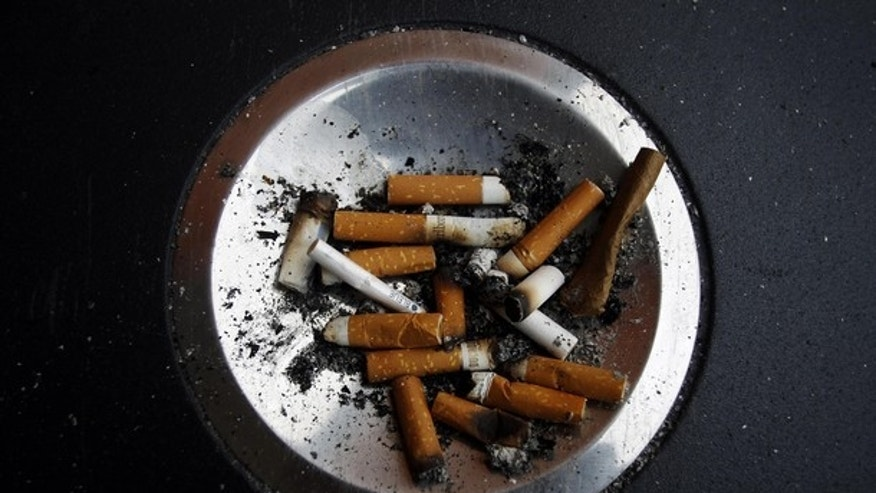 Cigarette butts are left in an ashtray at Atocha train station in Madrid January 1, 2011. A new Spanish anti-smoking law will take effect on January 2 that will prohibit smoking in all enclosed spaces as well outside hospitals, at playgrounds and schools. The Spanish Socialist government wants to put the country in line with the European Union's strictest anti-smoking nations.         REUTERS/Susana Vera (SPAIN - Tags: SOCIETY POLITICS)