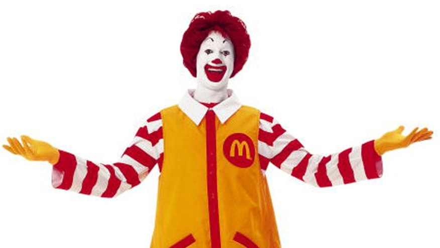 FILE - In this file photo released by McDonald's Corp., a familiar Ronald McDonald in his trademark yellow jumpsuit is shown. Some branding experts think the McDonald's Corp. clowns' floppy red shoes and flaming-red hair are too hackneyed for iPod-savvy kids.  (AP Photo/McDonald's Corp., file)