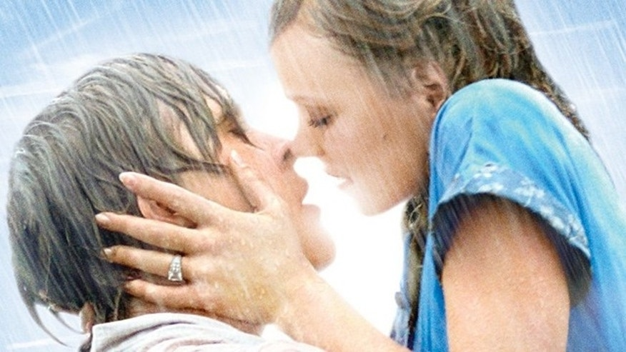 "Noah (Ryan Gosling) and Allie (Rachel McAdams) kiss passionately in a scene from ""The Notebook."""