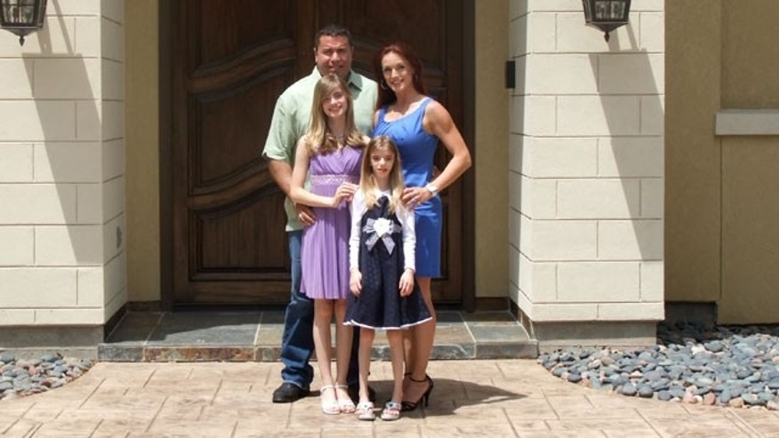 Sinny and Sierra pose with their parents, Chrissy and Joey, Easter 2011. (Not pictured: the girls' brother, Austin, 16).
