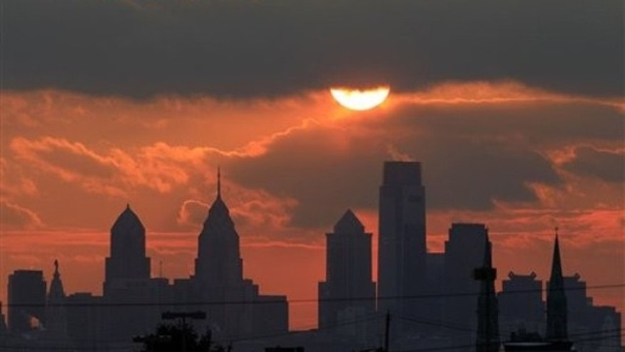 The sun is seen low in the sky before it sets behind the city skyline of Philadelphia on Friday, Jan. 14, 2011.