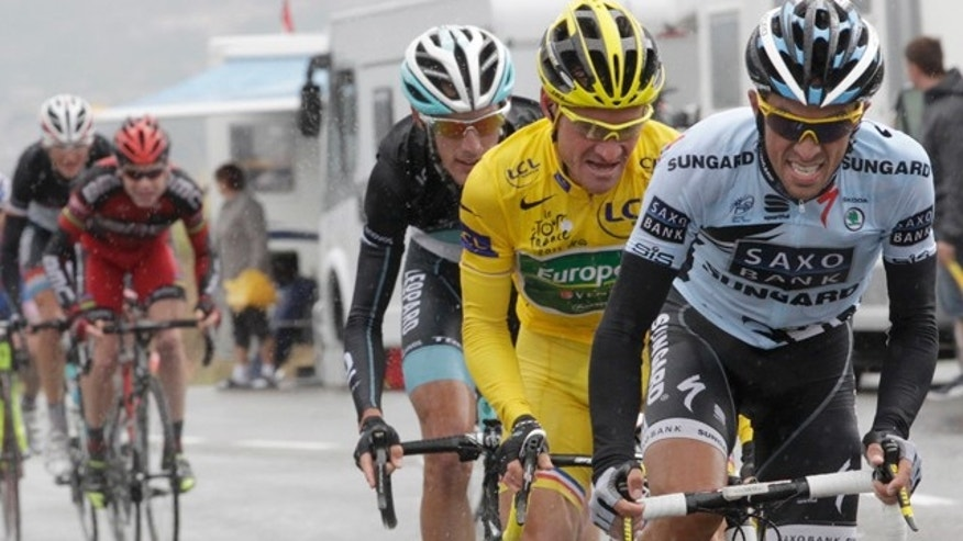 Saxo Bank rider Alberto Contador of Spain (R) cycles ahead of Europcar rider and race leader Thomas Voeckler of France (2nd R) and Leopard rider Andy Schleck of Luxembourg (C), BMC rider Cadel Evans of Australia (2L) and Leopard rider Frank Schleck of Luxembourg (L) during the 16th stage from Saint-Paul-Trois-Chateaux to Gap at the Tour de France 2011 cycling race July 19, 2011.