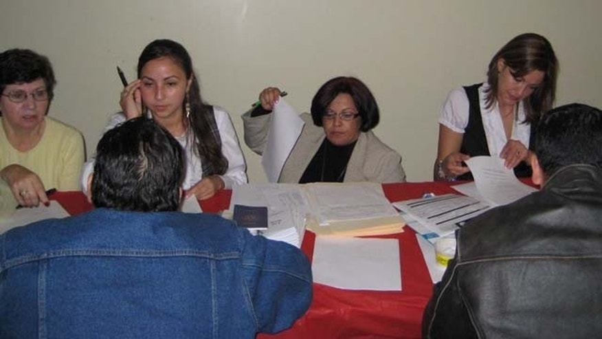 Massachusetts residents enrolling for healthcare at the Latino Health Insurance Program.