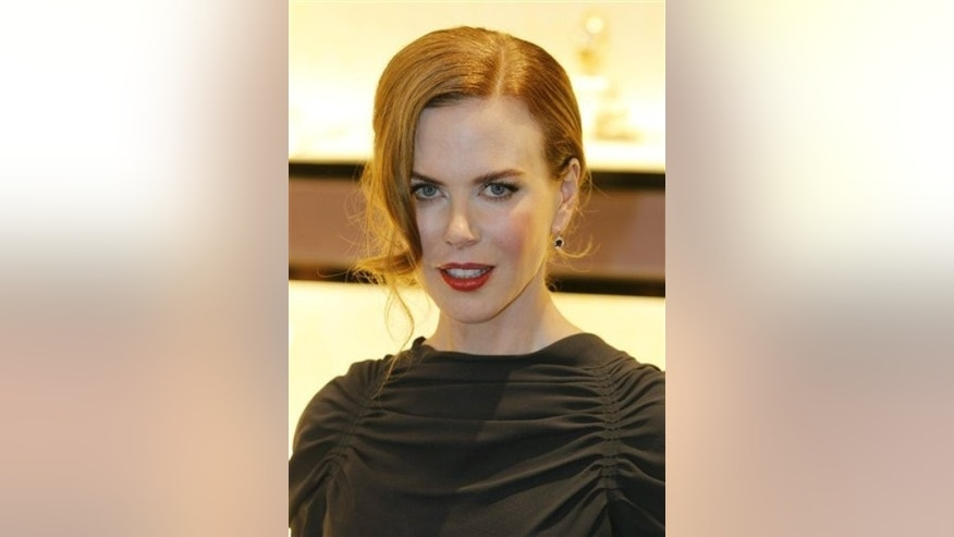 Australian actress Nicole Kidman poses during a promotional event for a watch brand in Hong Kong Thursday, May 20, 2010.  (AP Photo/Kin Cheung)