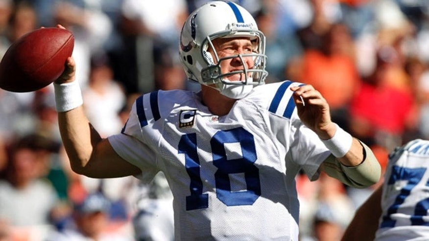 Indianapolis Colts quarterback Peyton Manning looks for a receiver during the second half of an NFL football game against  the Denver Broncos on Sunday, Sept. 26, 2010, in Denver. The Colts won 27-13. (AP Photo/Barry Gutierrez)
