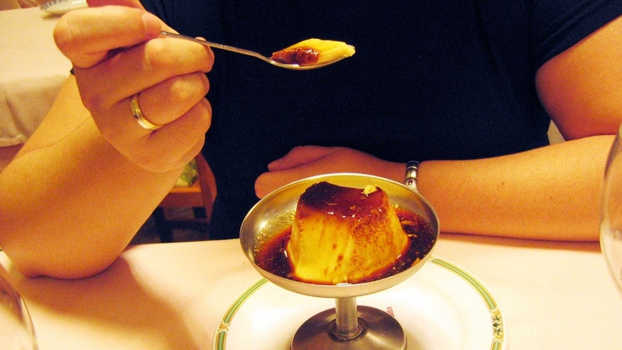 A woman eating a custard in a restaurant of Monforte. Lugo. Galicia.  (Photo by Xulio Villarino/Cover/Getty Images)