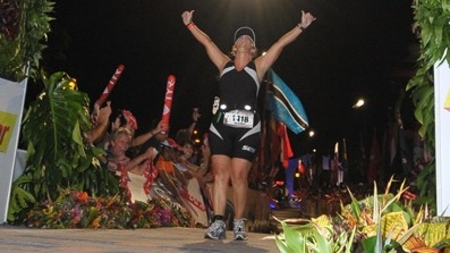 Desiree Hart-Wilson, of Washington, completes the Kona Ironman.