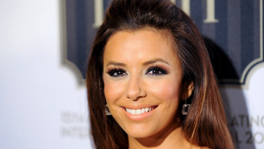 "Actress Eva Longoria arrives at the 2011 Los Angeles Latino International Film Festival special screening of ""Without Men"" during the Maya Indie film series in the Hollywood area of Los Angeles, California, July 24, 2011. REUTERS/Gus Ruelas (UNITED STATES - Tags: ENTERTAINMENT)"