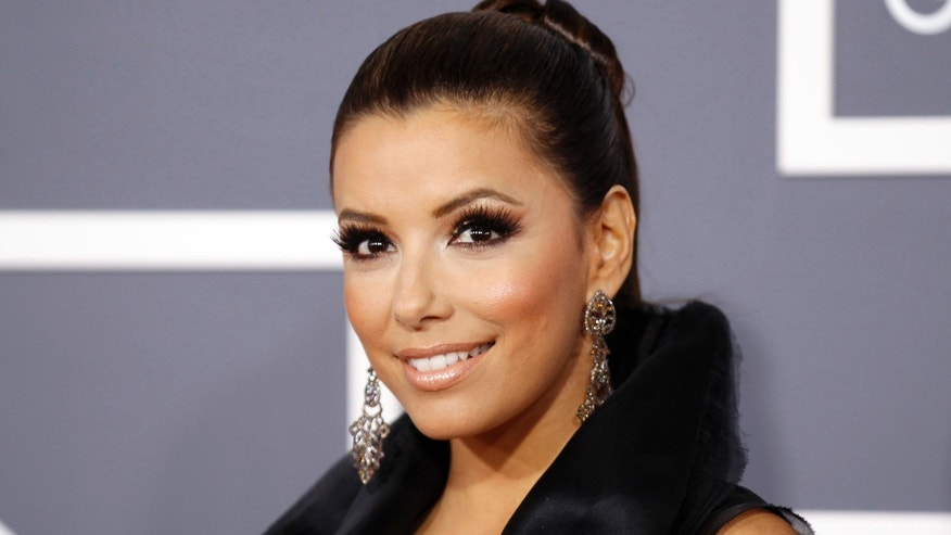 Actress Eva Longoria poses on arrival at the 53rd annual Grammy Awards in Los Angeles, California February 13, 2011. REUTERS/Danny Moloshok (UNITED STATES - Tags: ENTERTAINMENT HEADSHOT) (GRAMMYS-ARRIVALS)