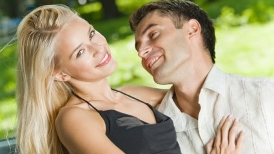 Young happy amorous couple together, outdoors