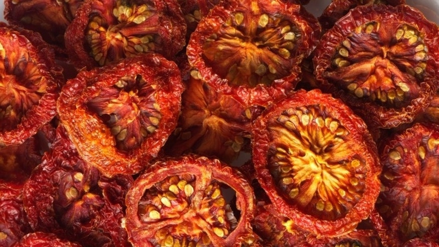 A Beautiful pile of sun dried tomatoes.