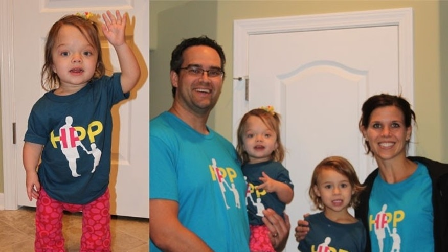 Evie Elsaesser, 2, and her family: Mom Lindsey, father John, and sister Lyla, 4.