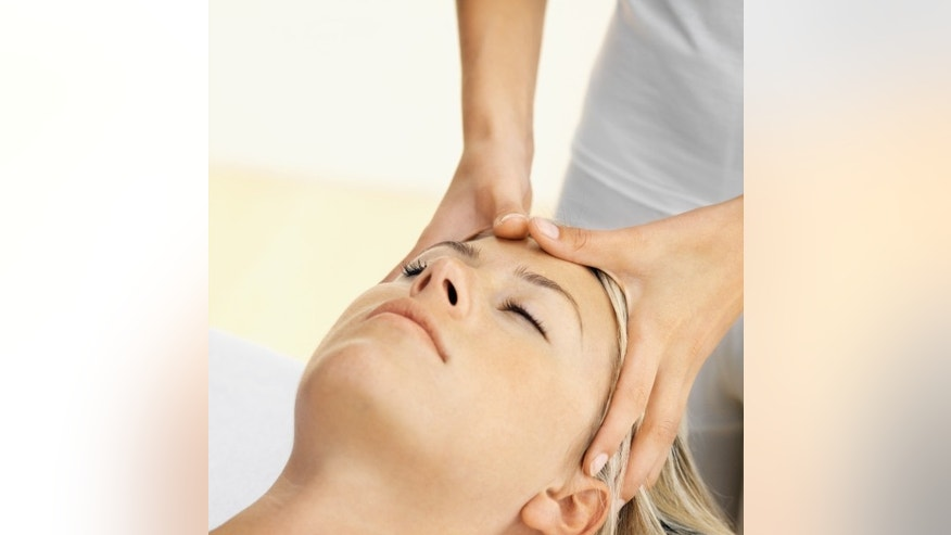 Close up of a woman receiving a head massage