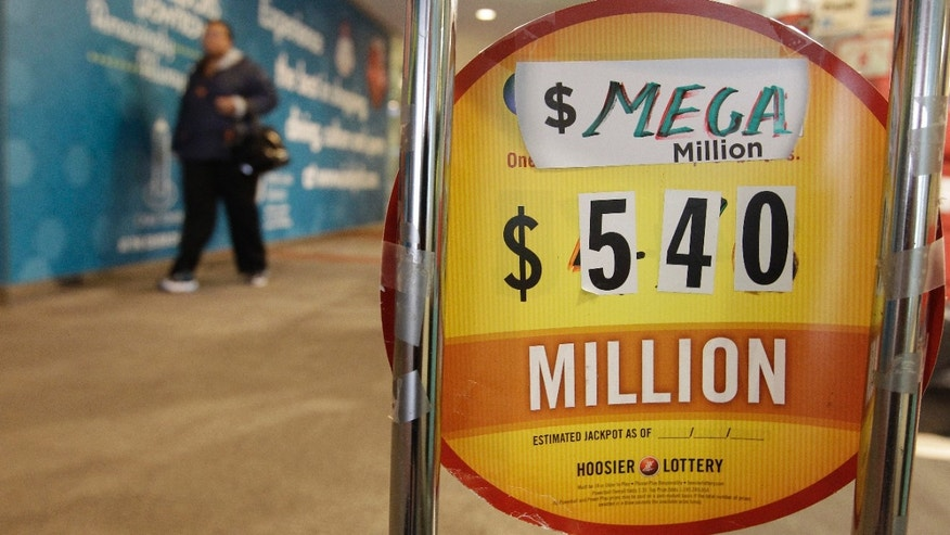 A sign is posted in front of Kanti's with the estimated value of the Mega Millions jackpot Thursday, March 29, 2012, in Indianapolis. (AP Photo/Darron Cummings)
