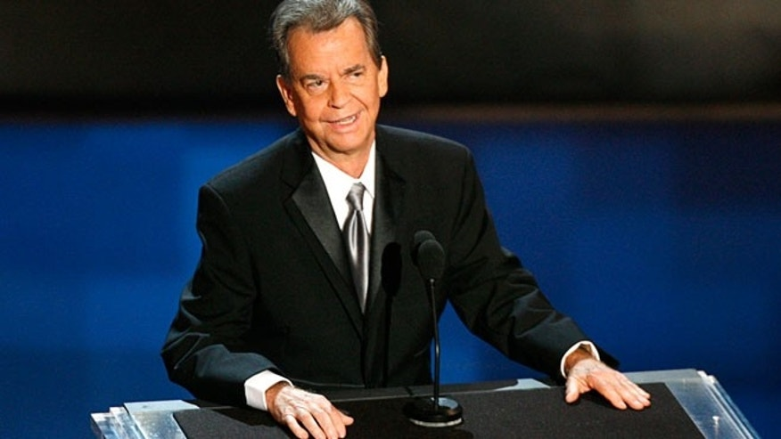 FILE: Dick Clark stands onstage during a tribute to him at the 58th annual Primetime Emmy Awards in Los Angeles in August of 2006