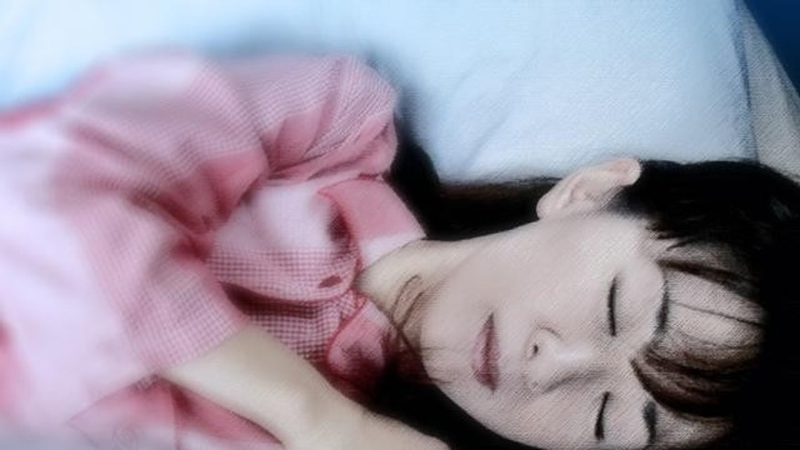 "Junko Suzuki, a radio DJ, demonstrates how she sleeps with a ""Boyfriend's Arm Pillow"" in Tokyo Friday, Sept. 24, 2004.  The pillow manufactured by linen maker Kameo Corp. consists of a headless torso and a stuffed arm that curls around the sleeper. It might make some people uneasy but have sold about 1,000  in Japan since the product went on the market last December. The maker says the pillow is not only an emotional comfort, but that its shape keeps the body balanced by supporting the sleeper from both sides. (AP Photo/Koji Sasahara)"