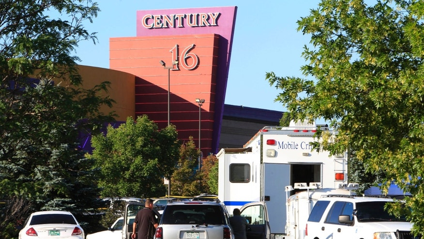 July 20, 2012: Police officers arrive at the Century 16 theatre east of the Aurora Mall in Aurora, Colo., on Friday.