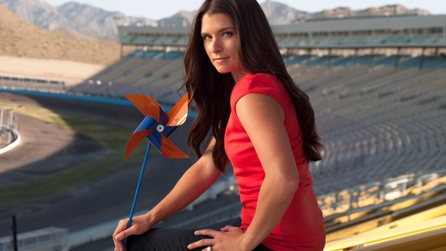 Danica Patrick holds a pinwheel, the symbol for COPD awareness