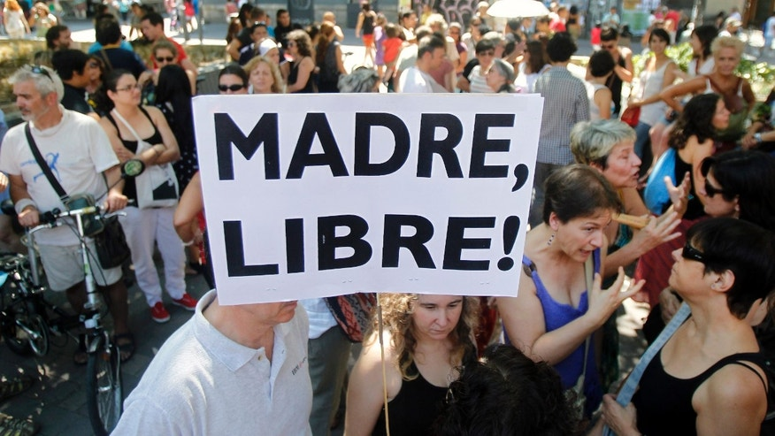 "A protester shows a banner that reads: ""Free Mother"" during the protest against abortion law reform in Madrid, Spain."
