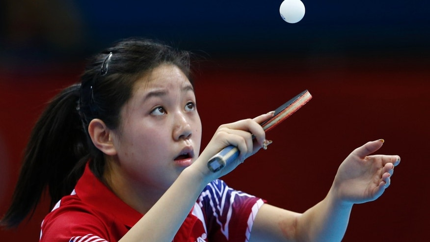 July 28, 2012: Lily Zhang of the U.S. serves to Croatia's Cornelia Molnar during their women's singles first round table tennis match in the ExCel venue at the London 2012 Olympic Games.