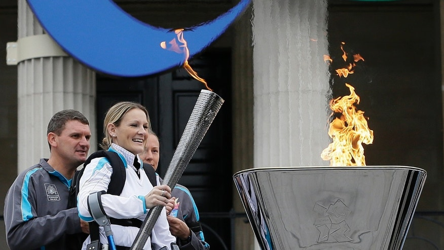 Aug. 24, 2012: Claire Lomas lights the Paralympic flame cauldron in Trafalgar Square in London.